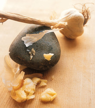 puree raw garlic with a rock