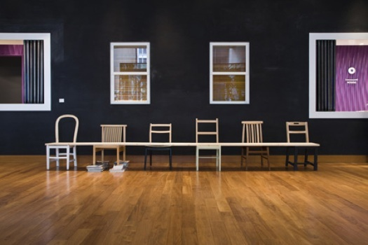 a bench made of chairs