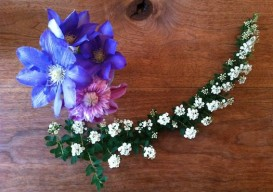 vaseless flower arrangement on a table