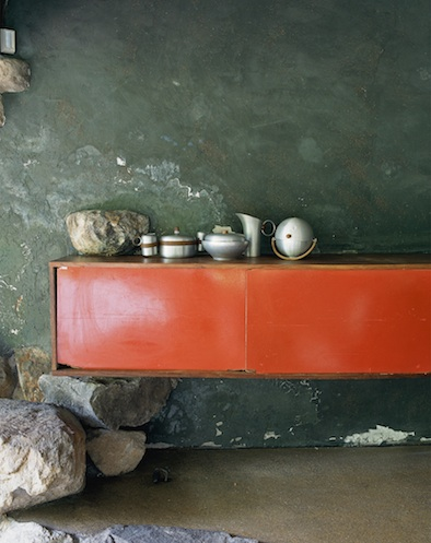 Artists' Handmade Houses Russel Wright sideboard on rocks