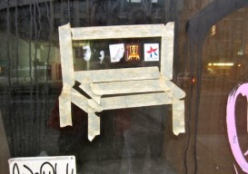 tape chair on window grafitti