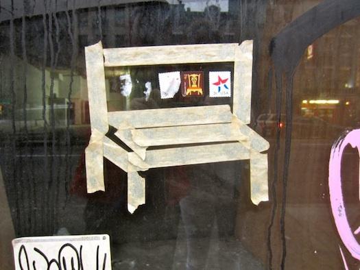 tape chair on window grafitti