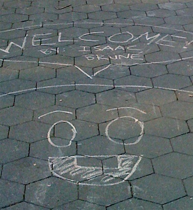 chalk welcome on the sidewalk Isaac Brune