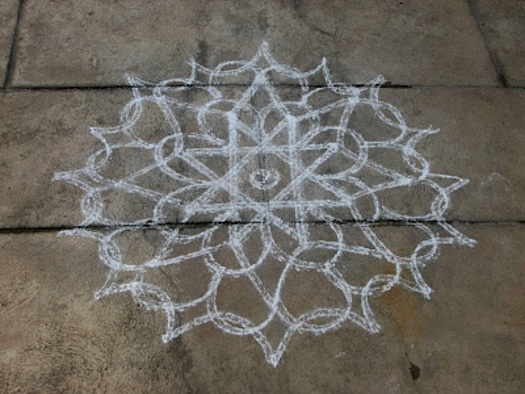 Indian chalk welcome kolam