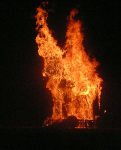 Burning Man Trojan Horse on fire