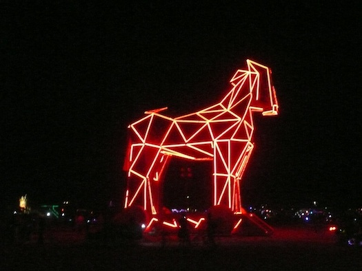 burning man neon trojan horse