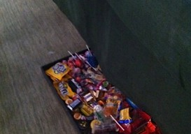 Halloween candy stash under the sofa