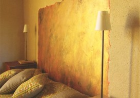 headboard painted on wall in gold paint