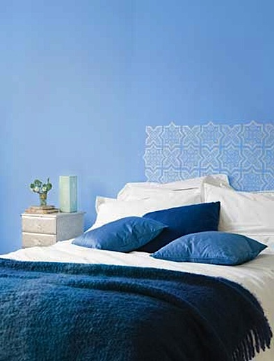 headboard stenciled on wall