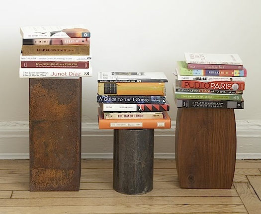 found pipes, and metal and wood boxes book stands