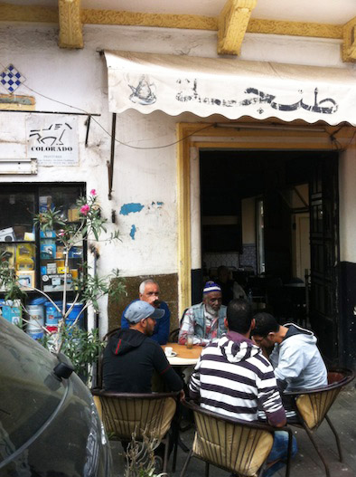 tangier men drinking coffee waiting for work