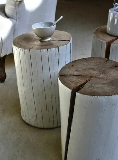 painted cut tree trunk stools and seats