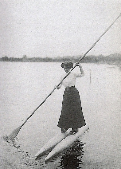 vintage photo of woman navigating lake on boat shoes