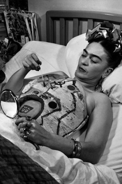 Frida Kahlo painting her body cast
