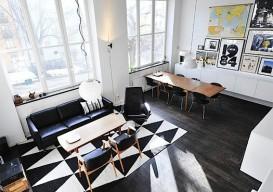 geometric rug on black floor