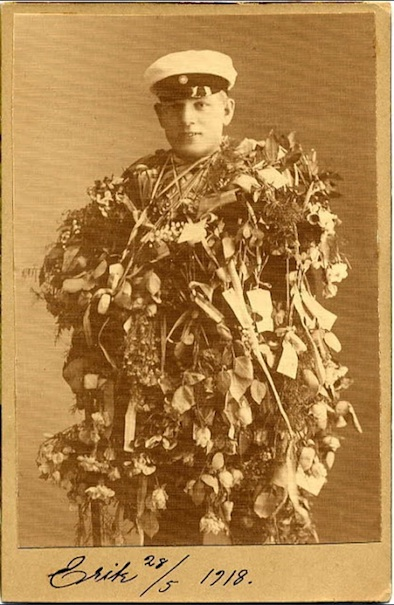 Cabinet card of man covered in flowers and leaves
