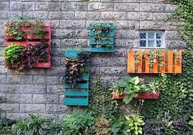 colorful planters made of shipping pallets
