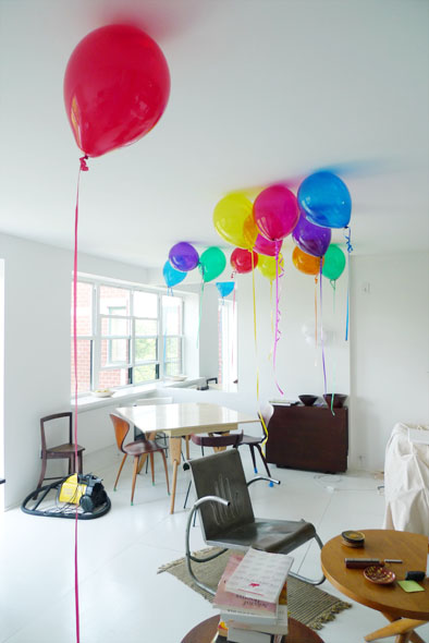 color helium balloons hanging out on the ceiling