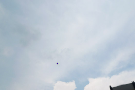 liberated helium balloon in the air
