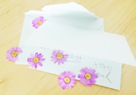 a letter with pressed flowers
