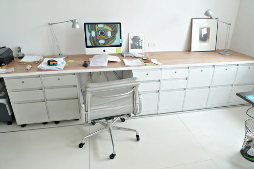 long desk made of hollow core doors