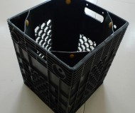 chici garbage can made from a bottled water crate