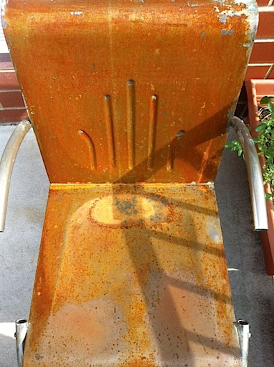 steel chair in the process of rusting