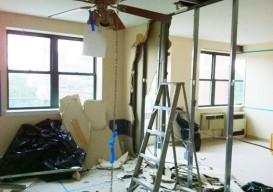 sheetrock wall demolished with a shovel improvised life