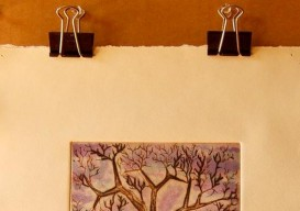 use binder clips to hang art without hurting it