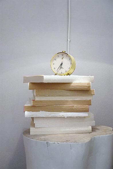 books with covers torn off stacked as decorative element