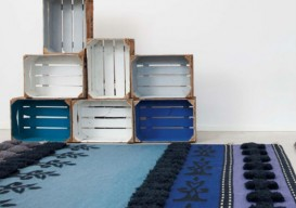 Vintage staggered and stacked crates in blues and white