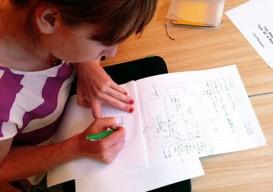 Emily Johnson notating plans for Improvised Life Laboratory