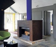 a cor-ten steel fireplace makes for a chic industrial look
