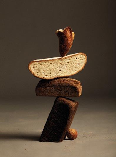 balancing bread photo by nacho alegre