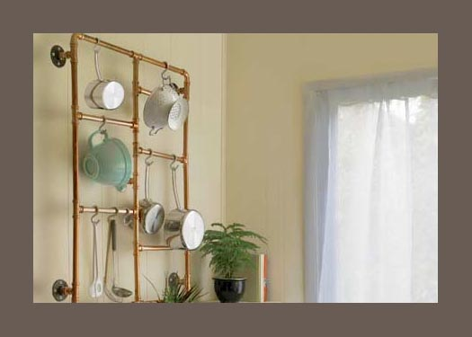 a pot rack made from copper tubing