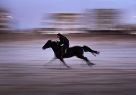 A Palestinian man rides a horse on the beach at sunset in the central Gaza strip on Jan. 11.