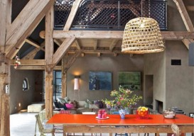 orange tabletop in an open rustic living space