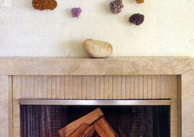 fossils, stones, geodes decorating a fireplace