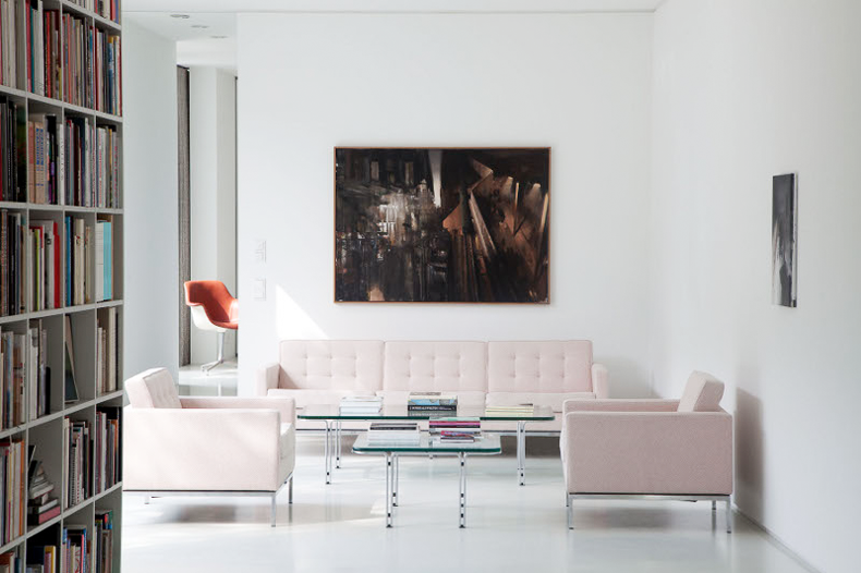 sitting room with books and pale pink couch