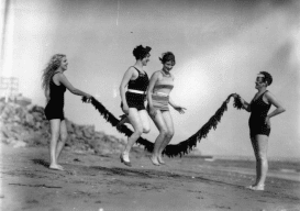 Girls jumping rope with seaweed, circa 1928