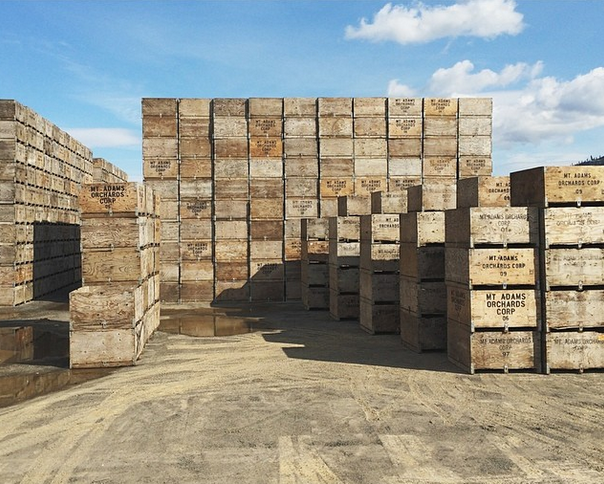 a shipping yard stacked with crates from Colombia