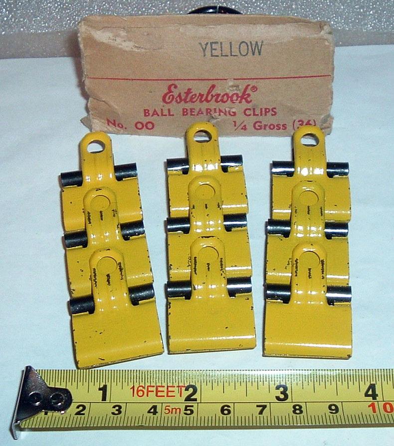 antique vintage yellow Esterbrook clips