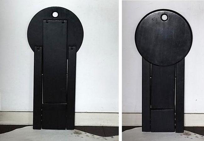 2 black Roger Tallon stools