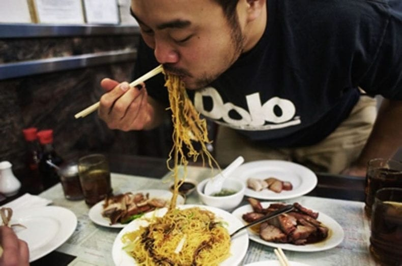 david-chang-eating-ginger-scallion-noodles-gabriele-stabile